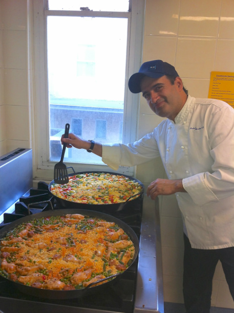 Rolando cooking Paella at Chapel's Flicks by the Sea Event